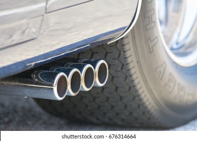 Chrome exhaust pipes on a muscle car