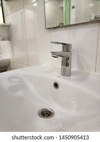 Chrome faucet washbasin mixer. Close-up. Workers dormitory.