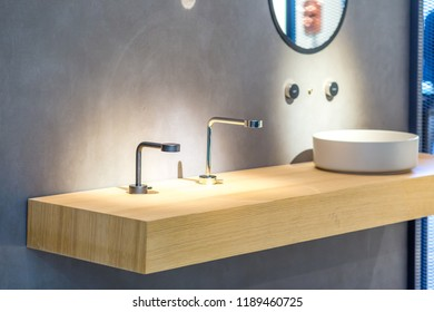 chrome faucet and white sink on wooden vanity top