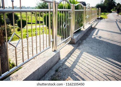 Chrome fence with gate. Stainless steel fence
