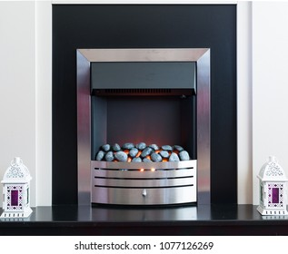 Chrome Fire Surround with light from the coals.