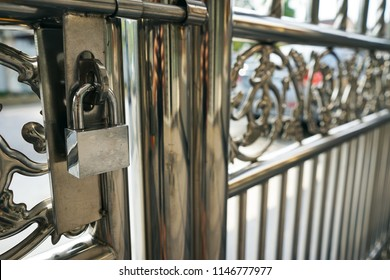 chrome lock hanging in stainless steel fence