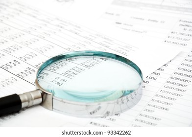 chrome Magnifying Glass and document close up
