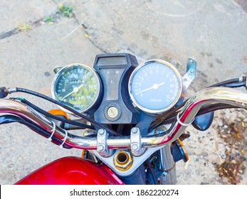 Chrome motorcycle handlebar with wires speedometer and tachometer. Closeup photo
