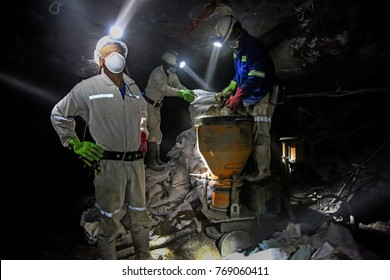 Chrome and Platinum mine, North Eastern part of South Africa; 05/23/2011 Illustrative Editorial image of Platinum/Chrome miners working underground. Mixing concrete. PPE Protection gear being used