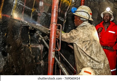 Chrome and Platinum mine, North Eastern part of South Africa; 05/23/2011 Illustrative Editorial image of Platinum/Chrome miners drilling holes in rock for blasting. Holes used for dynamite placement