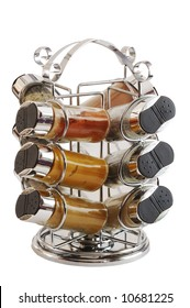 Chrome spices rack containing 12 bottles with different kinds of spices isolated on white