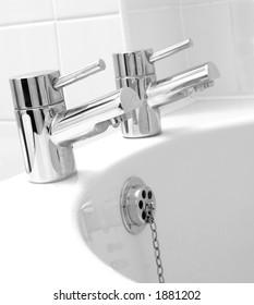 Chrome taps & waste on white bath