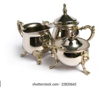 Chromed silver tea set on white background