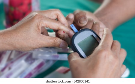 Chronic disease, patients blood to the fingertips to check their blood sugar.