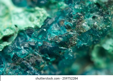 Chrysocolla is a hydrated copper cyclosilicate It has the chemical formula (Cu,Al)2H2Si2O5(OH)4nH2O.Cyan (blue-green) crystal. Macro. Beautiful fantastic background for successful Your projects