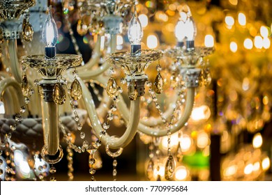 Chrystal chandelier glowing background with copy space.