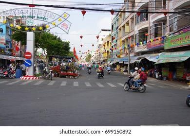 CHUA PHUOC AN, VIETNAM - FEB 7, 2015 - Motorbikes on central avenue, Chua Phuoc An, Vietnam