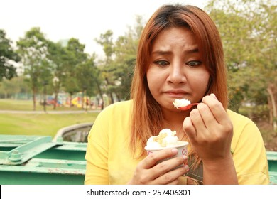 Chubby girl with guilty feeling to eat ice cream