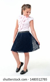 Chubby teen girl in school clothes on a white background.