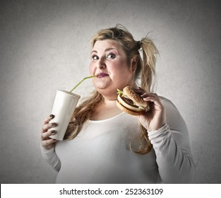 Chubby woman eating snacks