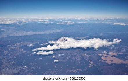 Chubu / Japan - Jan 1, 2018: Aerial view of Mount Fuji with surrounding clouds.