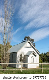 The chuch of England St Luke in Australia cloudy blue sky and tree without leaves background Southern Highlands Glenquarry NSW South Sydney Country building rural architecture 16th June 2019