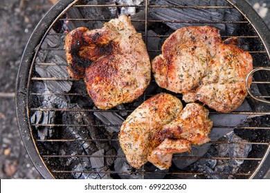 Chuck steak being grilled, outdoors