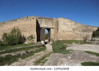 CHUFUT-KALE, REPUBLIC OF CRIMEA / RUSSIA - SEPTEMBER 19 2018: East gates to the cave city of Chufut-Kale in Crimea