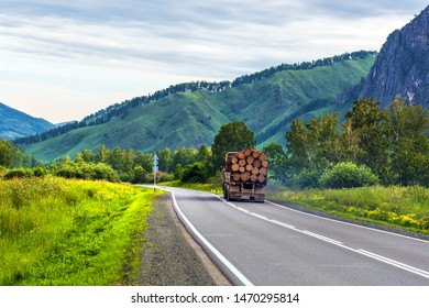 Chui tract, Shebalinsky district, Altai Republic, southern Siberia, Russia - July 13, 2019: truck loaded with sawn tree trunks moves along Chui tract