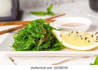 Chukka seaweed salad with peanut sauce, lemon and roasted sesame seeds. Sea vegetable salad with soy sauce.