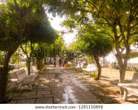 chulgiri, jaipur, rajasthan, india, 1st january 2019: greenery with benches to sit in sunshine