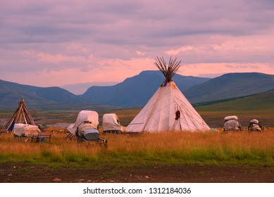 Chum (home of nomadic reindeer herders) against the backdrop of the mountains of the Polar Urals in the early summer morning. Yamal, Russia