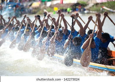 CHUMPHON ,THAILAND-NOV 3 : Unidentified rowers in Climbing Bows toward Snatching a Flag native Thai long boats compete during Native Long Boat Race Championship on Nov 3, 2012 in Chumphon ,Thailand .