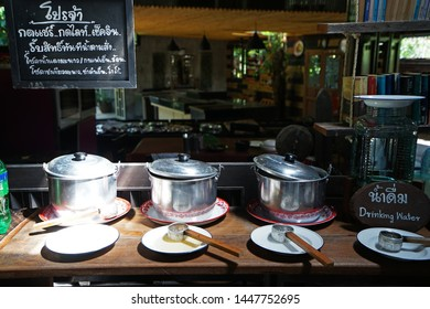 CHUMPHON,THAILAND-JUNE 2,2019:Arrangement of buffet self service station at 'NAIMUANG khaolak' local southern Thai restaurant -Thai board means 'Like or Check in get free complimentary drinks'