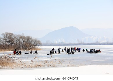 Chuncheon city, Korea - December, 2014 : It is the people fishing in the Ouiam Lake of Chuncheon City. Many people come and enjoy fishing when the lake is frozen in winter.