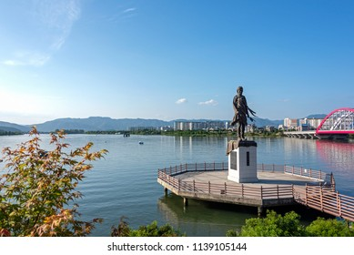 """Chuncheon, South Korea - June 16, 2018: A statue of a virgin built on the banks of the Soyang River. This is a bronze statue set up to promote the Korean song """"Soyanggang Virgin"""" and the Soyang River."""