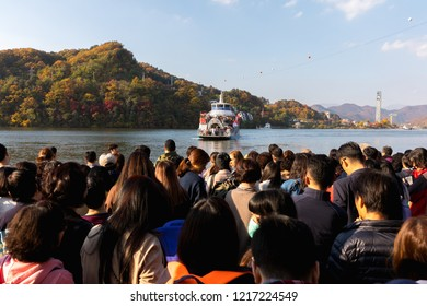 Chuncheon, South Korea - October, 2018: Ferry with full of tourists Leaving the pier of Nami or Namiseom island, the resort island in Chuncheon city to South Korea in on October 24, 2018 in Chuncheon