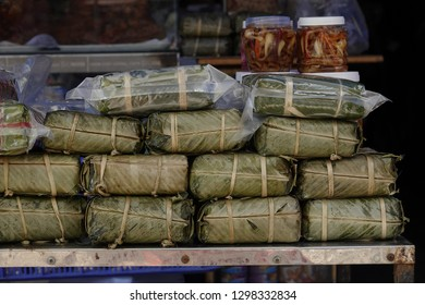 chung cake, or banh chung is the most popular food on tet holiday, made from stuff sticky rice, pork meat and green bean then wrap in dong leaves or banana leaves, steamed over night and serve