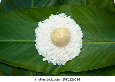 Chung Cake ingredients. Square shape wood mold with glutinous rice, split mung beans, chunks of pork shoulder, salt, pepper, bamboo, banana leaves, long node string.