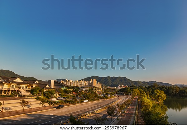 Chungju city cityscape in South Korea with old traditional and modern building architecture, central road, mountain and lake