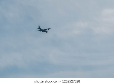 Chungju, South Korea; December 02, 2018; Military C130 four engine turboprop aircraft flying in partly cloudy blue sky near Chungju airport.
