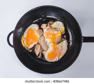Chunk of fruit bread isolated on a white background Scrambled eggs and bacon on frying pan on a white background  closeup