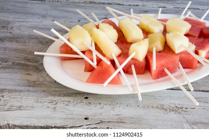 Chunks of melon and watermelon served on a plate
