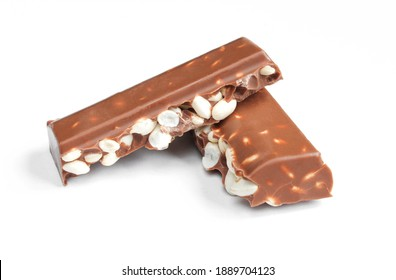 Chunks of milk chocolate with puffed rice isolated on white background