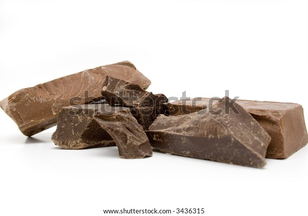 Chunks of milk and dark chocolate on a white background