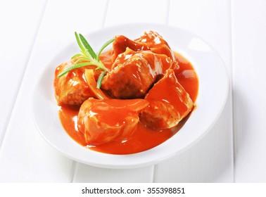 Chunks of pork meat in tomato sauce
