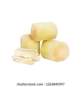 Chunks of Raw Sugar Cane against isolated on white background, Cane Cutting, Sugarcane piece cut fresh, Sliced Sugar cane, Pile of Sugarcane bagasse, sugarcane residue fresh nature (selective focus)