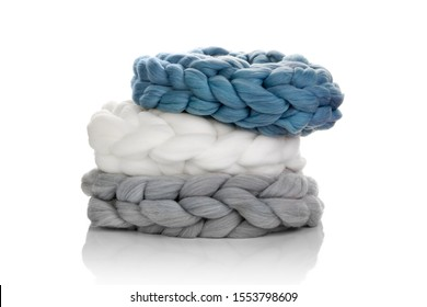 Chunky merino wool scarfs isolated on white background. Modern lifestyle.