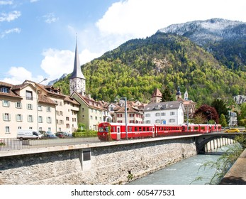 Chur, Switzerland: Panorama of the old town by train of the Rhaetian Railway in the foreground