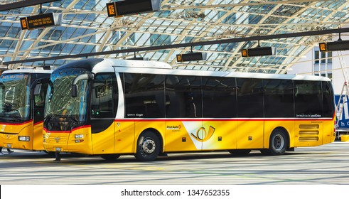 Chur, Switzerland - September 27, 2018: PostAuto buses at the bus station in the city of Chur. PostAuto is a subsidiary company of the Swiss Post, which provides regional and rural bus services.