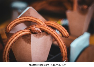 Churas, sweet dessert fried roasted dough and packed in a paper envelope, craft pack. Copy Space