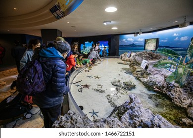 Churaumi Aquarium, Okinawa, Japan - January 9, 2019 : One of the world's largest fish tank. There are many peoples coming to visit one of the best aquarium in Japan.