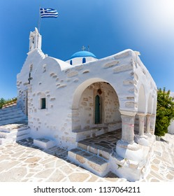 The church of Agios Konstantinou, a traditional, whitewashed cycladic building with blue dome, situated over the town of Paroikia, Paros, Greece