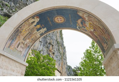 Church arch in front of the mountain in Montenegro